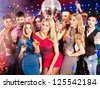 Group people with  champagne dancing at party. Disco ball. - stock photo
