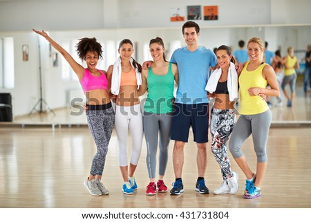 Group photo of smiling sporty people on fitness class after training - stock photo