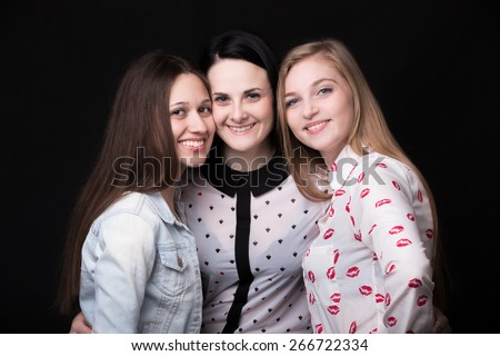 Group photo of three beautiful girlfriends happy smiling together - stock photo