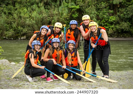 GROUP PHOTO OF WHITE WATER RAFTING GROUP BEFORE THE DEPARTURE, SPECIFIC EQUIPMENT  - stock photo