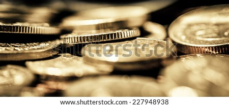 Group / Pile of gold coins of varying currencies shot on a macro lens - stock photo