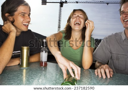 Group Playing Spin the Bottle - stock photo