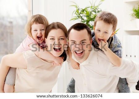 Group portrait of a playful family - stock photo
