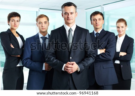 Group portrait of a professional business team looking confidently at camera