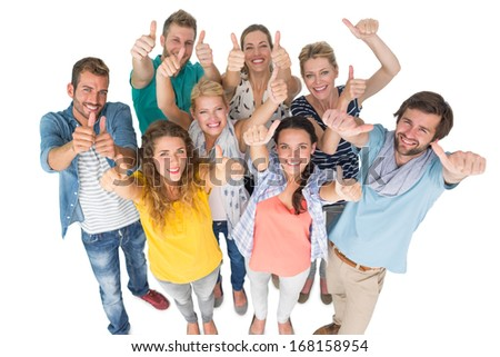 Group portrait of casual cheerful people gesturing thumbs up over white background - stock photo