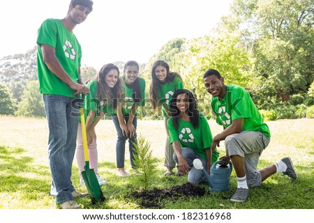 Group portrait of confident environmentalists gardening in park - stock photo