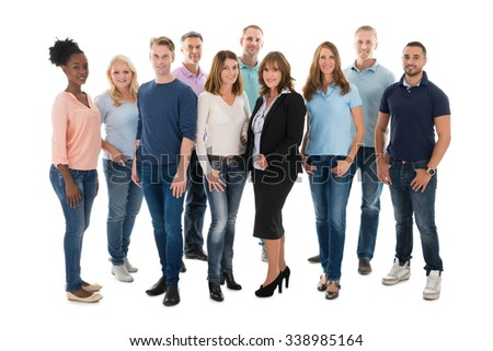 Group portrait of creative business people standing together over white background