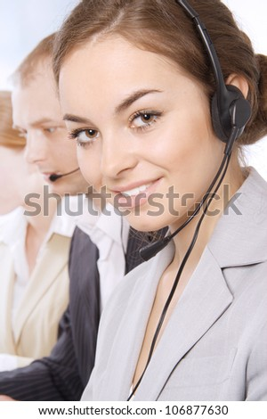 Group portrait of customer service representatives, with focus on young beautiful brunette woman - stock photo