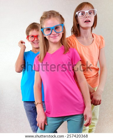 group portrait of cute funny kids with eyeglasses - stock photo