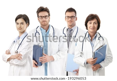 Group portrait of doctors on white background, looking at camera, smiling,