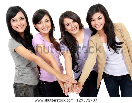 Group portrait of happy woman put hand together in the center