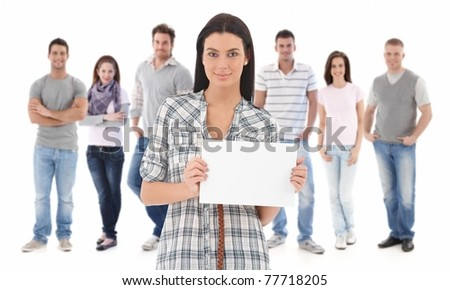 Group portrait of happy young people together, looking at camera, smiling. Young woman at front holding blank white sheet.? - stock photo