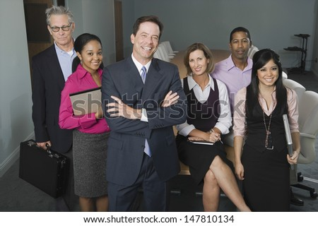 Group portrait of smiling multiethnic businesspeople - stock photo