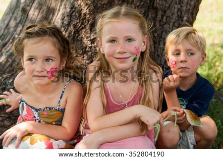 Group portrait of young children with face painting