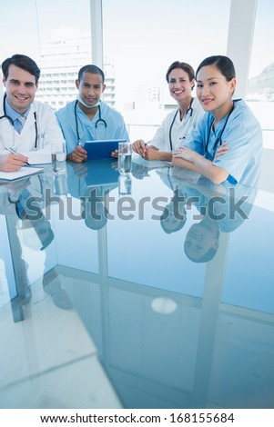 Group portrait of young doctors in a meeting at hospital - stock photo