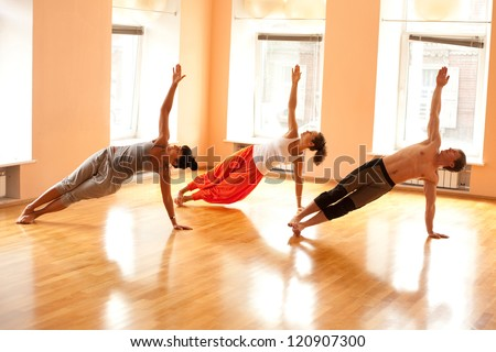 Group practicing yoga - stock photo