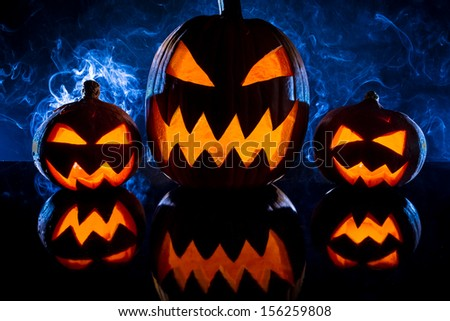 Group pumpkins for Halloween on a blue background - stock photo