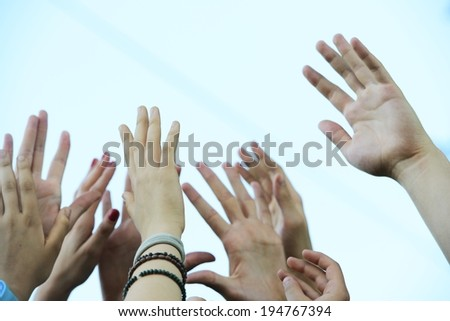 Group raising hands - stock photo