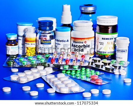 Group remedy at blue background.  Medicine. - stock photo