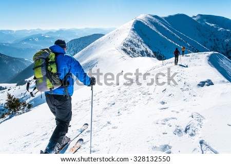 group skialpinists on snowy mountains