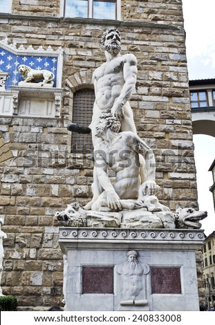 Group statue of Hercules and Cacus in front of the Palazzo Vecchio main entrance  - stock photo