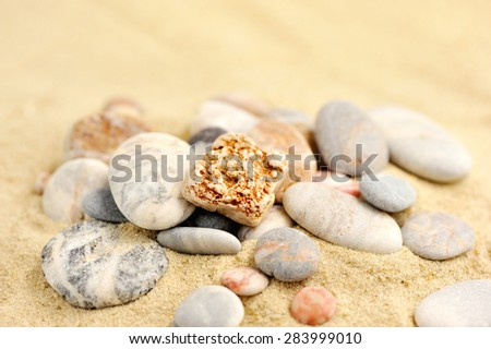 Group stones on the sand - stock photo