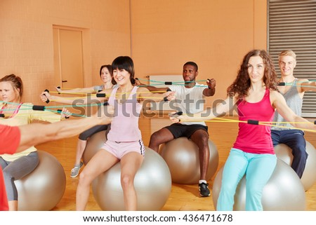 Group stretching with bands and training at the gym - stock photo