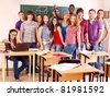 Group student in classroom near blackboard. - stock photo