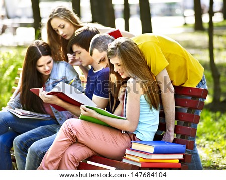 Group student with notebook on bench outdoor. - stock photo