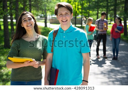 Group student with notebooks outdoor