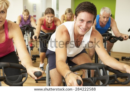 Group Taking Part In Spinning Class In Gym - stock photo