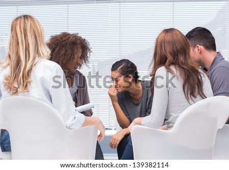 Group therapy and therapist - stock photo