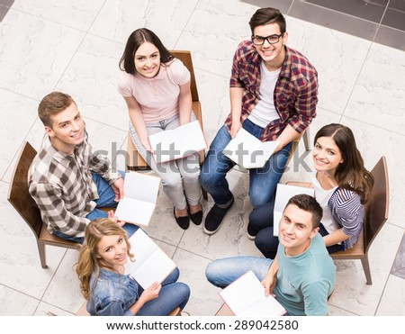 Group therapy. Group of people sitting close to each other and communicating. - stock photo