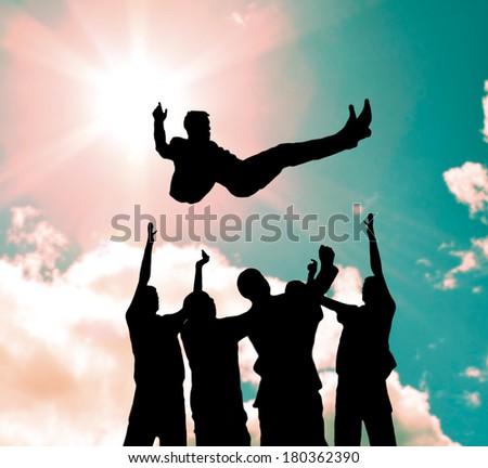 Group throwing winner. - stock photo