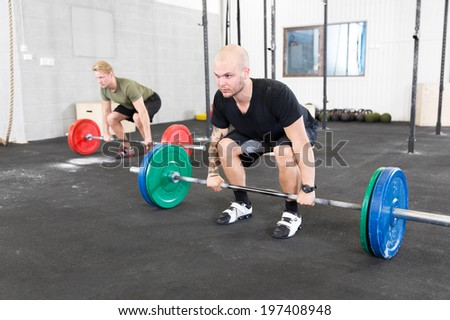 Group trains deadlift at fitness gym center - stock photo