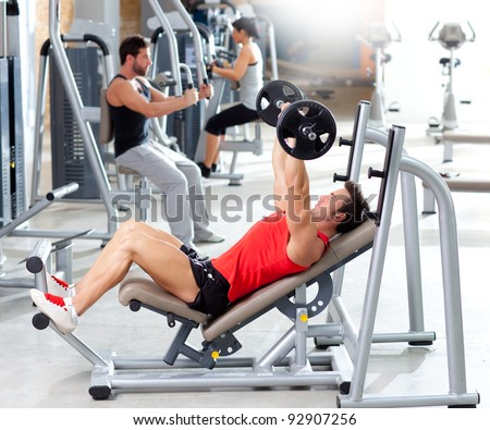 group with weight training equipment on sport gym club - stock photo