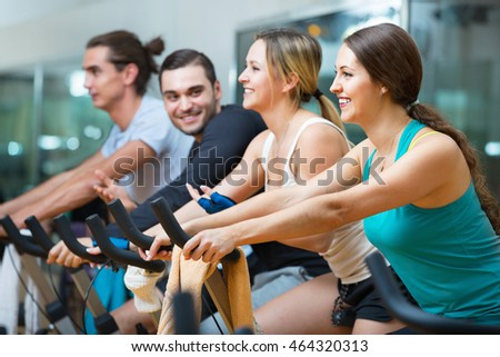 Group working out of cycling in modern fitness club