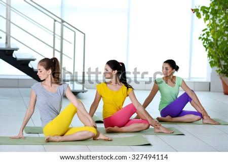 Group yoga exercise for young women