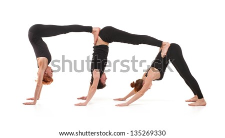 Group yoga. Two women and one men practicing yoga on a white background