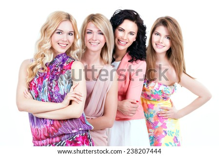 Group young beautiful smiling women in pink dresses - isolated on white. - stock photo