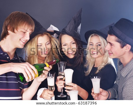 Group young people at nightclub drinking  champagne. - stock photo