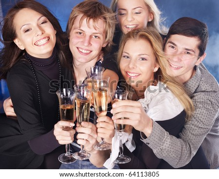 Group young people drink champagne at nightclub.