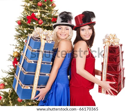 Group young people in party hat with christmas tree.