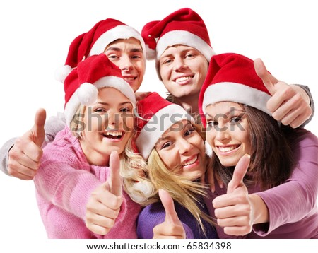 Group young people in santa hat show thumbs up. Isolated. - stock photo