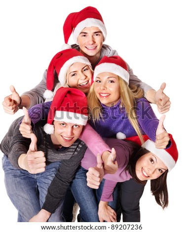Group young people in santa hat showing thumb up. Isolated. - stock photo