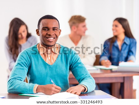 Group young people, students sitting at a table in the classroom