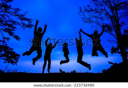 Grouping people jumping with silhouette in twilight time - stock photo