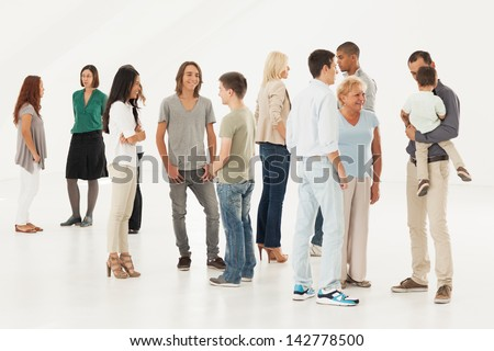 Groups of different people standing randomly and talking. - stock photo