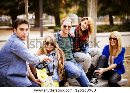 Groups of friends in the park - stock photo