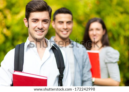 Groups of happy college students outdoor  - stock photo